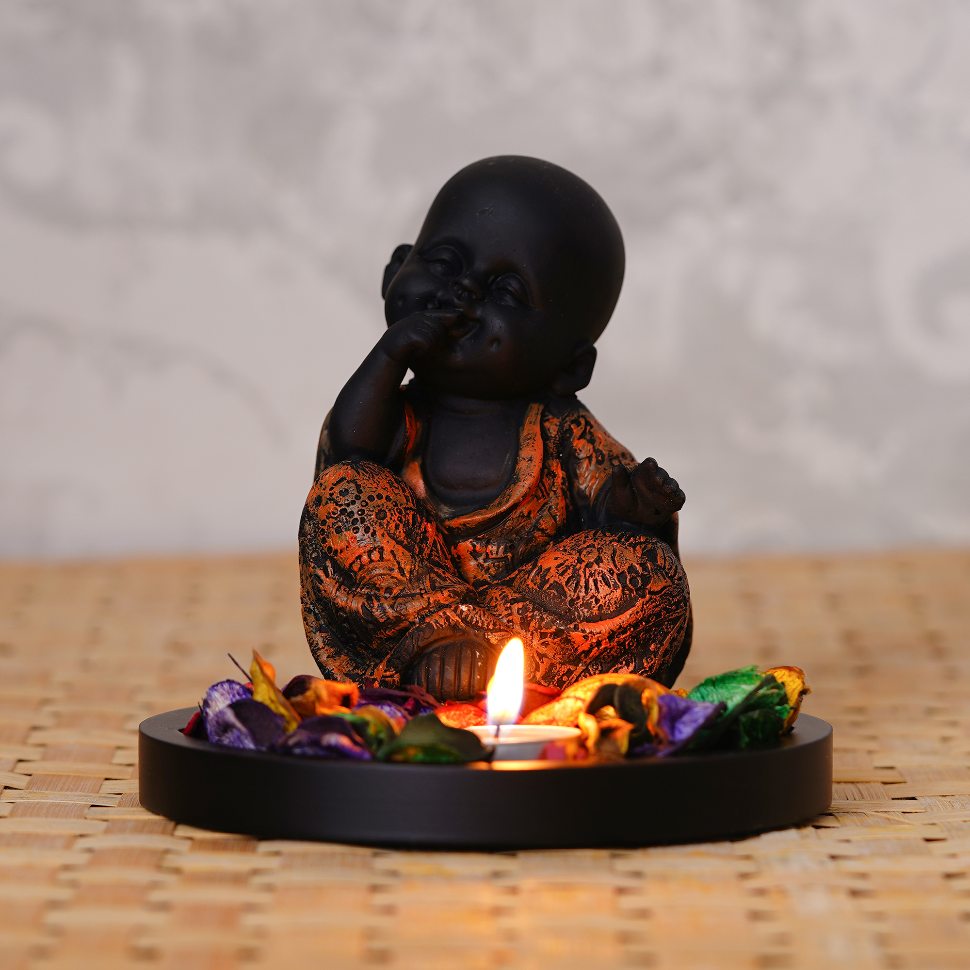 Decorative Smiling Copper Monk Buddha with Wooden Base, Fragranced Petals and Tealight Indian Home Decor