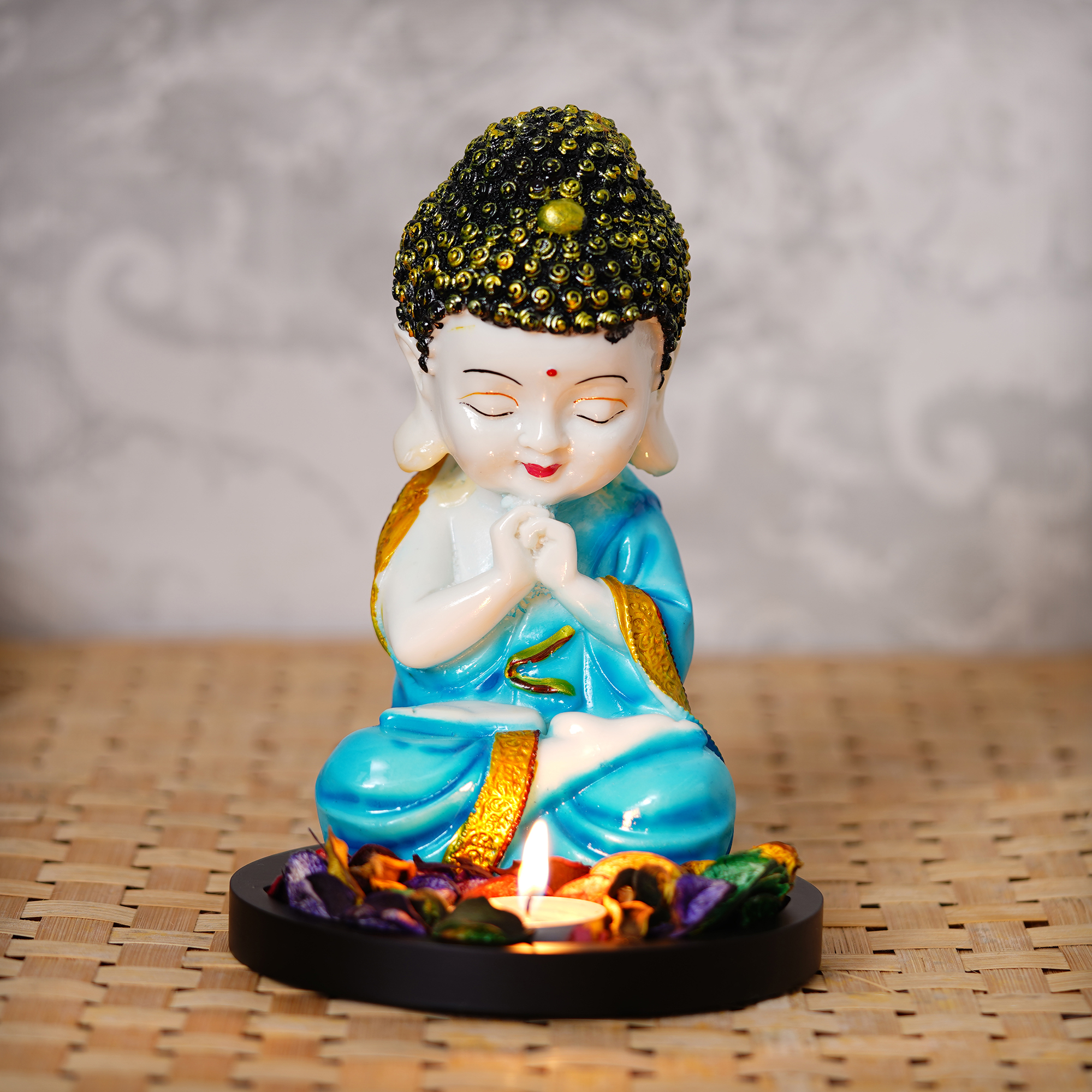 Praying Blue Monk Buddha with Wooden Base, Fragranced Petals and Tealight Indian Home Decor