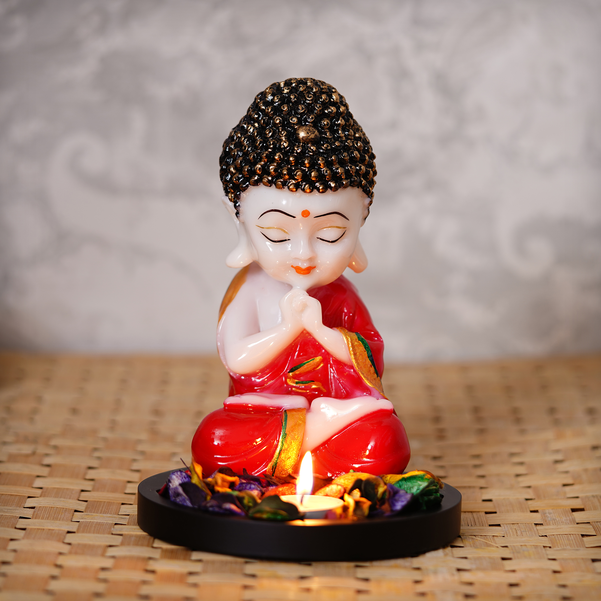 Praying Red Monk Buddha with Wooden Base, Fragranced Petals and Tealight Indian Home Decor