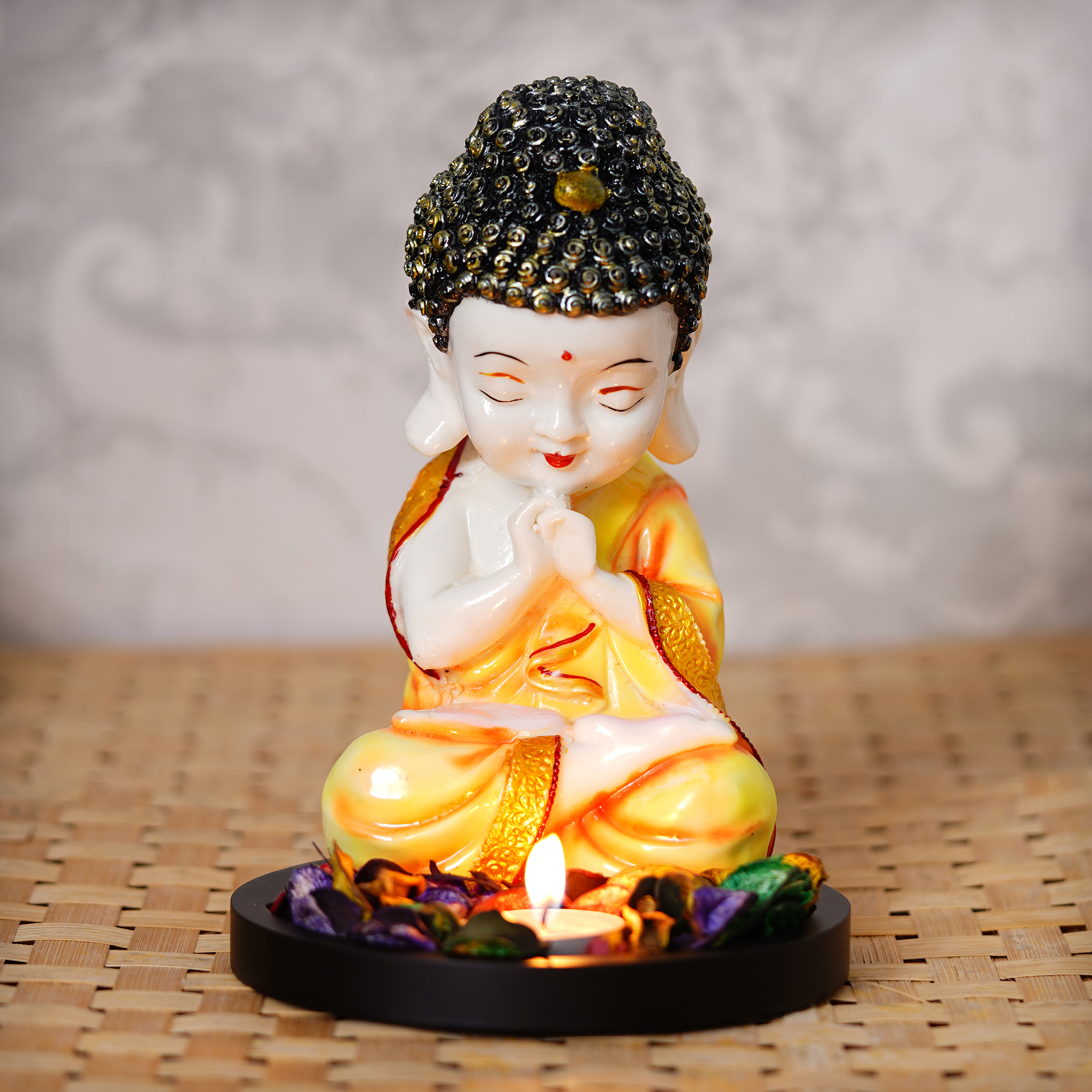 Praying Orange Monk Buddha with Wooden Base, Fragranced Petals and Tealight Indian Home Decor