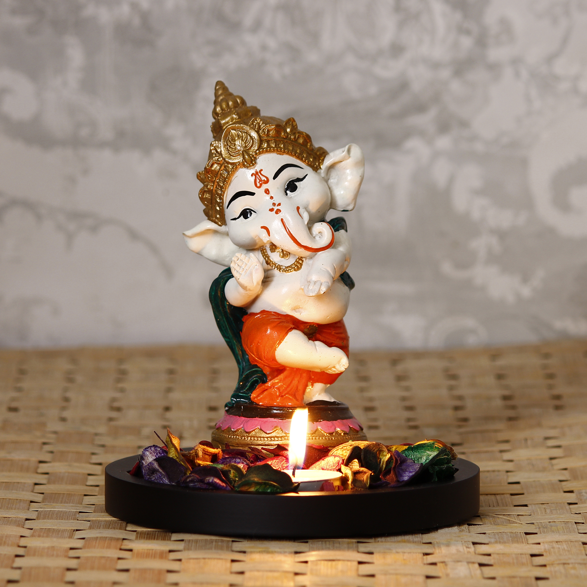 Colorful Lord Ganesha Dancing Avatar Decorative Showpiece with Wooden Base, Fragranced Petals and Tealight Indian Home Decor