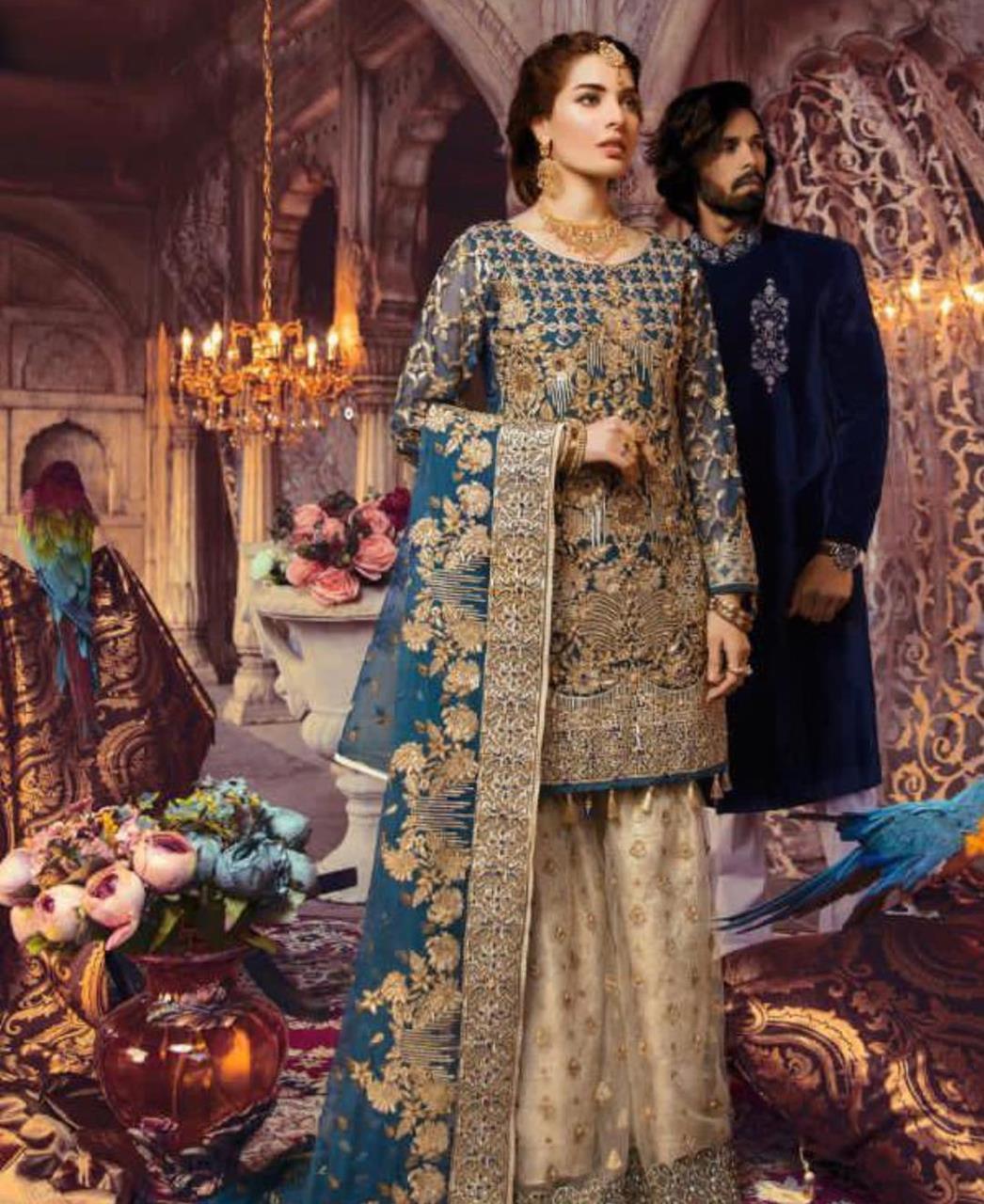 HandWorked Georgette Straight cut Salwar Kameez in Teal Blue