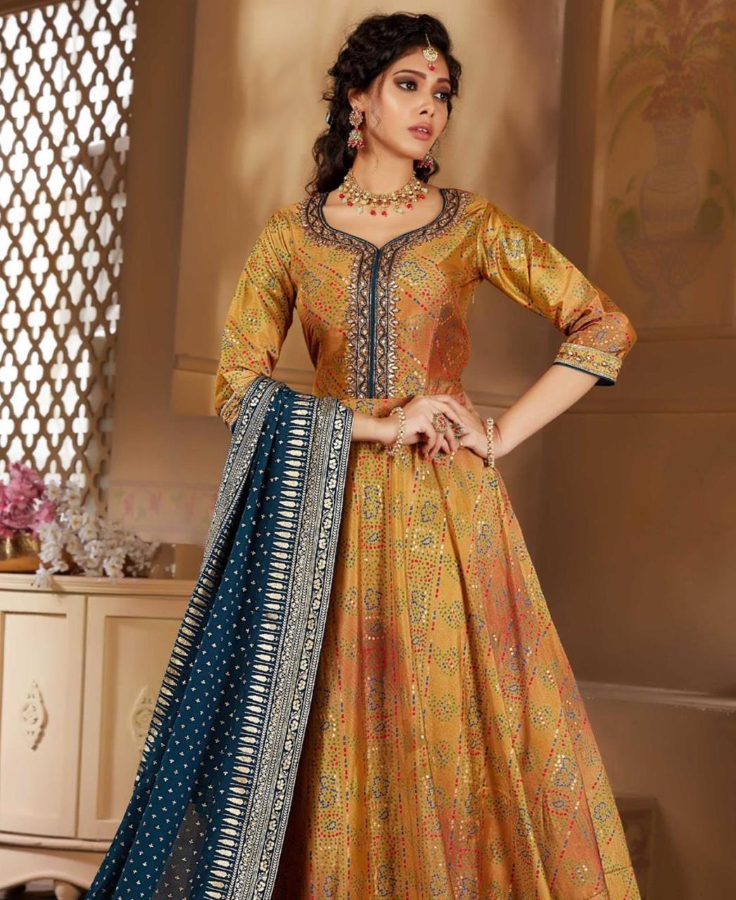 HandWorked Silk Straight cut Salwar Kameez in Yellow