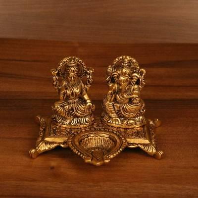 Gold Lakshmi, Ganesha with diya return gift