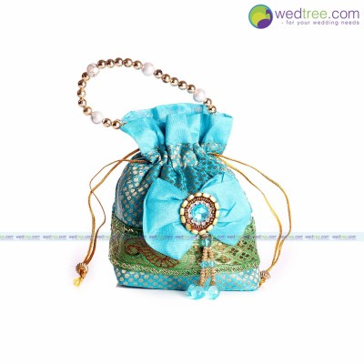 Polli Bag  - Potli bag made of silk cotton with golden dots and bow return gift
