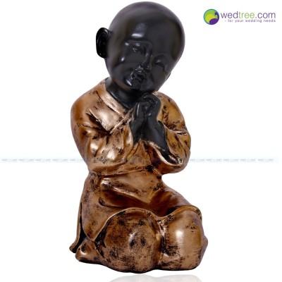 Thinking Baby Buddha - Baby Buddha Statue made of plaster of paris.