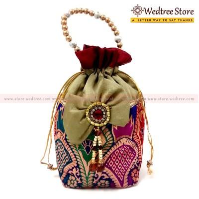Potli Bag  - Potli bag with heavy design made of silk cotton fabric return gift