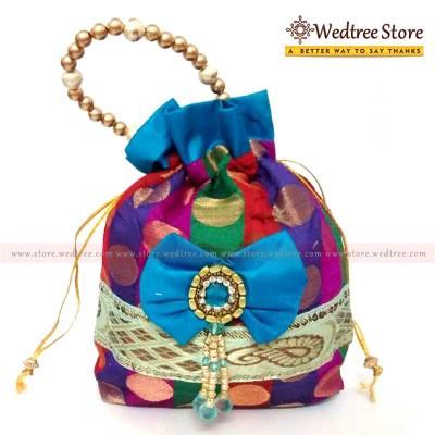 Potli Bag  - A Rich Golden Satin multi color Potli bag with golden dots return gift