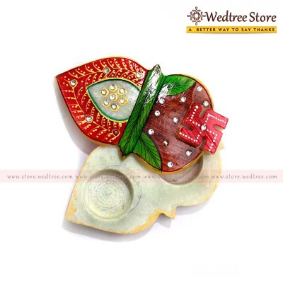 Kalash Chopra - Marvel in Marble---An attractive slide open kum kum holder in the shape of a kalash return gift