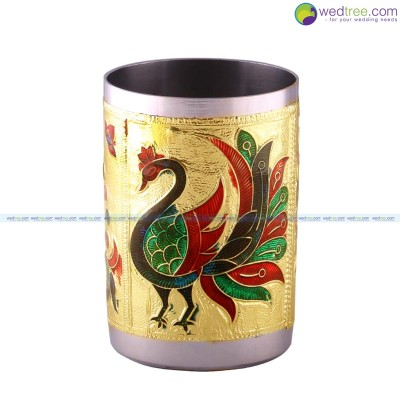 Glass  - Minakari----is the art of coloring and ornamenting the surface of metals by fusing over it brilliant colors that are decorated in an intricate design return gift
