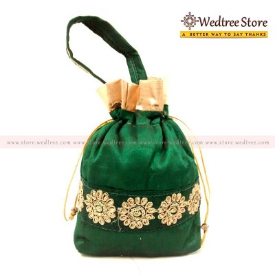 Potli Bag  - Potli bag made of green silk cotton with golden flowers as a lace in middle return gift