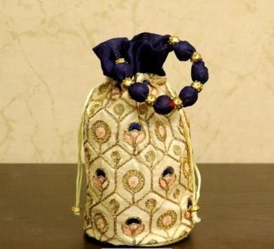 Potli bag with floral embroidery return gift