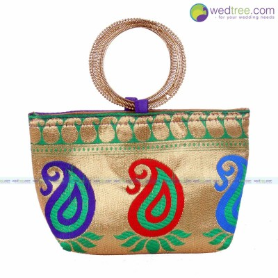 Hand Bag  - A Cute Bangle type bag made of raw silk with rich golden flower designs return gift