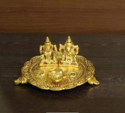 White metal gold finish Lakshmi Ganesha with diya return gift