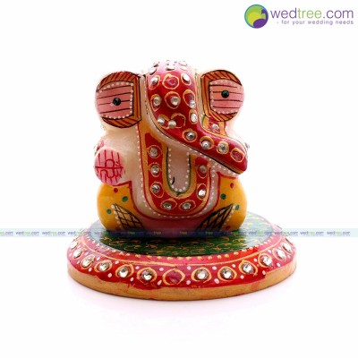 Ganesha - Marble ganesha in round stand painted and decorated with stones return gift