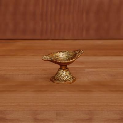 White metal diya swastik engraving gold finish return gift