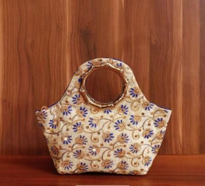 Hand bag raw silk with rich embroidery work return gift