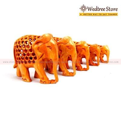 Jali Elephant Set of 5 - Elephants carved with a jali pattern.