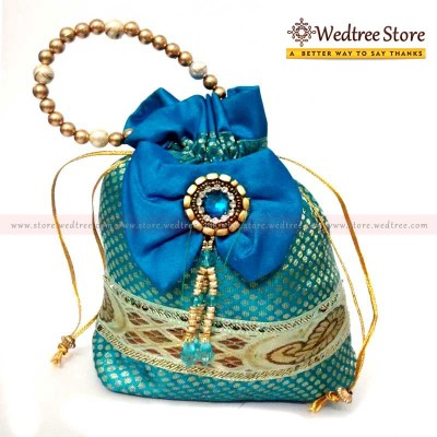 Potli Bag  - Potli bag made of silk cotton with golden dots and bow return gift