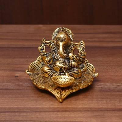 White Metal Ganesha in Pipal Leaf with Diya Gold Finish return gift