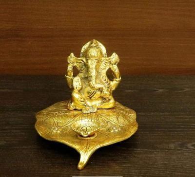 White metal gold finish Ganesha in pipal leaf with diya big return gift