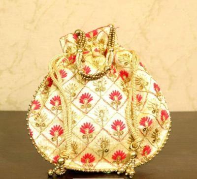 Potli bag with embroidery and chamki work return gift